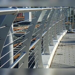 Close up of Kents light rail balustrade curved on a rail bridge