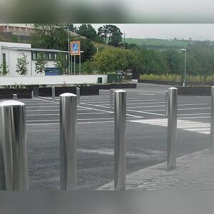 A row of Kents dome top bollards outside Aldi