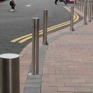 A row of Kents flat top bollards on a street