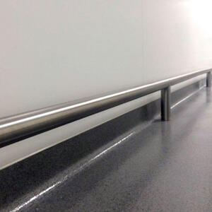 Close up of Kent's Floor Mounted Bump Rail in a factory