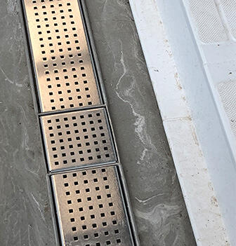 Stainless steel drain gratings by Kent