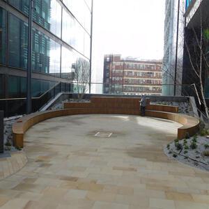 Amphitheater style outdoor seating with wood finish.
