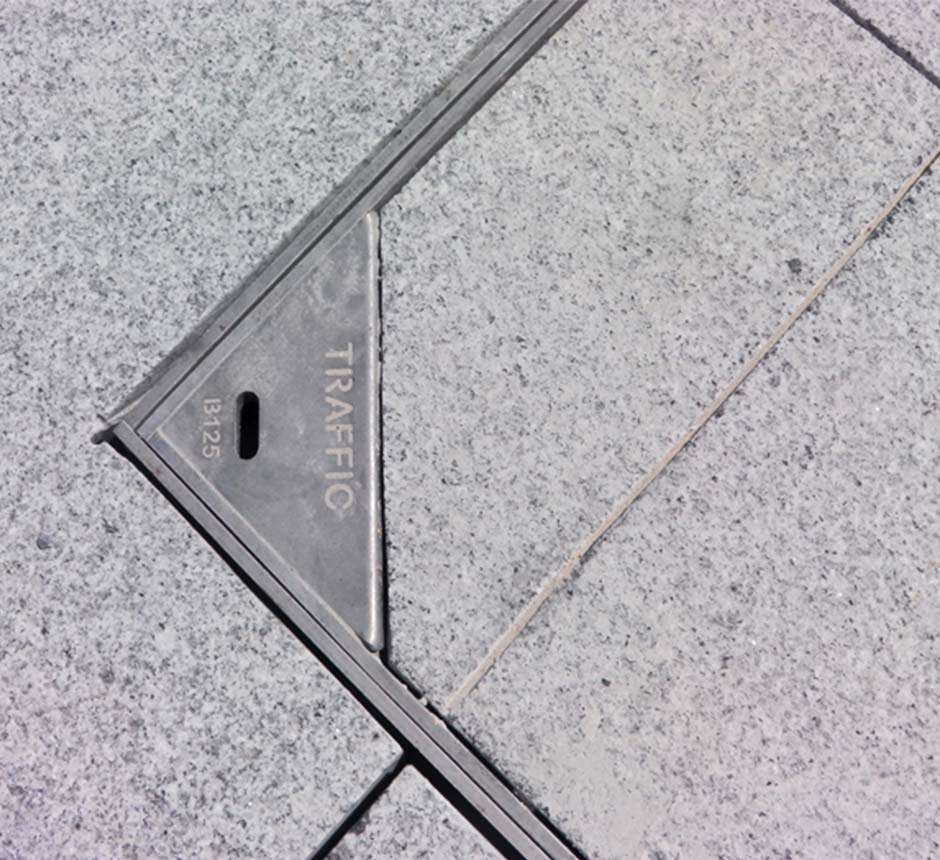 Close up view of Kent's Solo Paver in use