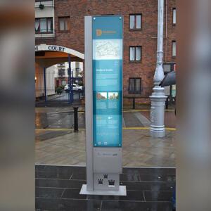 Dubline wayfinding monolith with bright peened finish