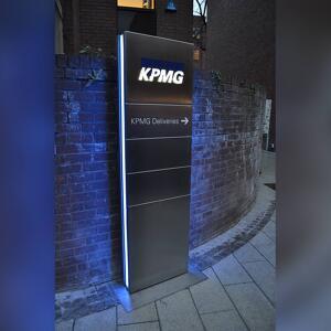 KPMG's wayfinding totem manufactured by kent stainless