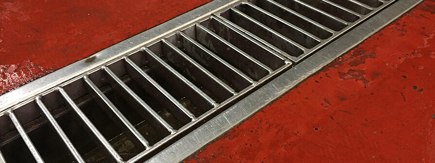 Close up view of Kent's stainless steel ladder grating